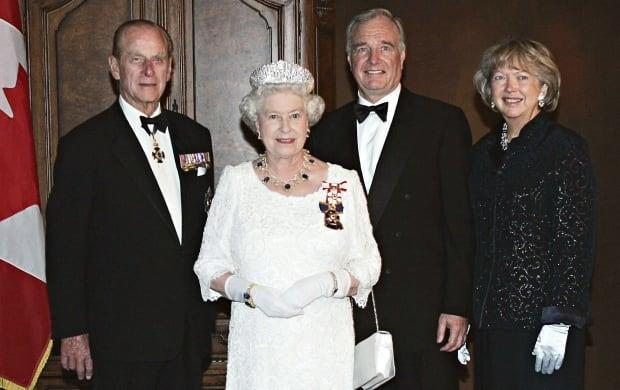 Queen Elizabeth II and Prince Philip pose for a photograph with Prime Minister Paul Martin and his wife Sheila prior to a state dinner on May 24, 2005 in Edmonton. The Queen was in Alberta to celebrate the province's centennial. (Paul Chiasson/Canadian Press)