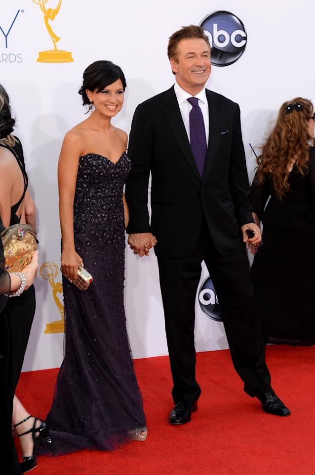 Alec Baldwin (L) and Hilaria Lynn Thoma arrive at the 64th Primetime Emmy Awards at the Nokia Theatre in Los Angeles on September 23, 2012.
