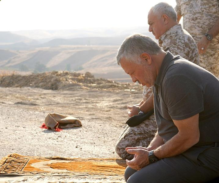 Jordan's King Abdullah prays as he take part in a ceremony, in an area known as Naharayim in Hebrew and Baquora in Arabic