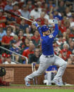 Chicago Cubs' Ian Happ hits an RBI-double during the seventh inning of a baseball game against the St. Louis Cardinals, Friday, Sept. 27, 2019, in St. Louis. (AP Photo/Scott Kane)