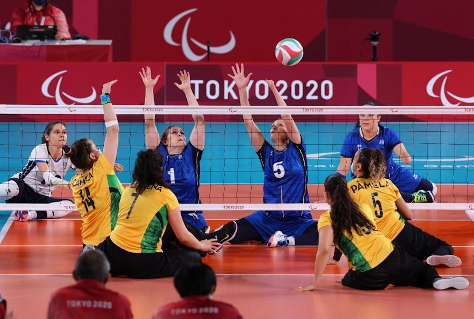 Brazil in action against Italy in the sitting volleyball today.