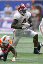 Alabama running back Brian Robinson Jr. (4) breaks away from Miami safety Keontra Smith (4) during the first half of an NCAA college football game Saturday, Sept. 4, 2021, in Atlanta. (AP Photo/John Bazemore)