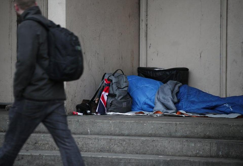 A homeless person sleeping rough in a doorway in Farringdon, London (PA)