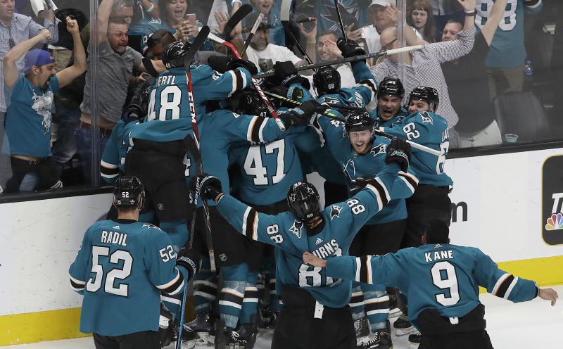 San Jose Sharks players celebrate after defeating the Vegas Golden Knights in Game 7 of an NHL hockey first-round playoff series in San Jose, Calif., Tuesday, April 23, 2019. The Sharks won 5-4 in overtime. (AP Photo/Jeff Chiu)