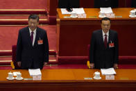 Chinese President Xi Jinping, left, and Premier Li Keqiang stand as they arrive for the opening session of China's National People's Congress (NPC) at the Great Hall of the People in Beijing, Friday, March 5, 2021. (AP Photo/Andy Wong)