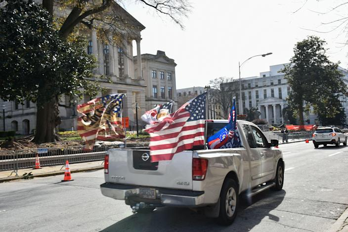 """Trump supporters gather in front of the Georgia State Capitol in Atlanta on January 6, 2021.<span class=""""copyright"""">Virginie Kippelen—AFP/Getty Images</span>"""