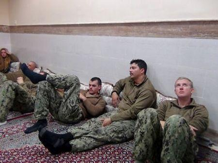 FILE PHOTO - An undated picture released by Iran's Revolutionary Guards website shows American sailors sit in an unknown place in Iran