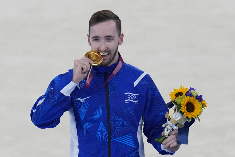 Artem Dolgopyat of Israel, poses after winning the gold medal on the floor exercise during the artistic gymnastics men's apparatus final at the 2020 Summer Olympics, Sunday, Aug. 1, 2021, in Tokyo, Japan. (AP Photo/Gregory Bull)