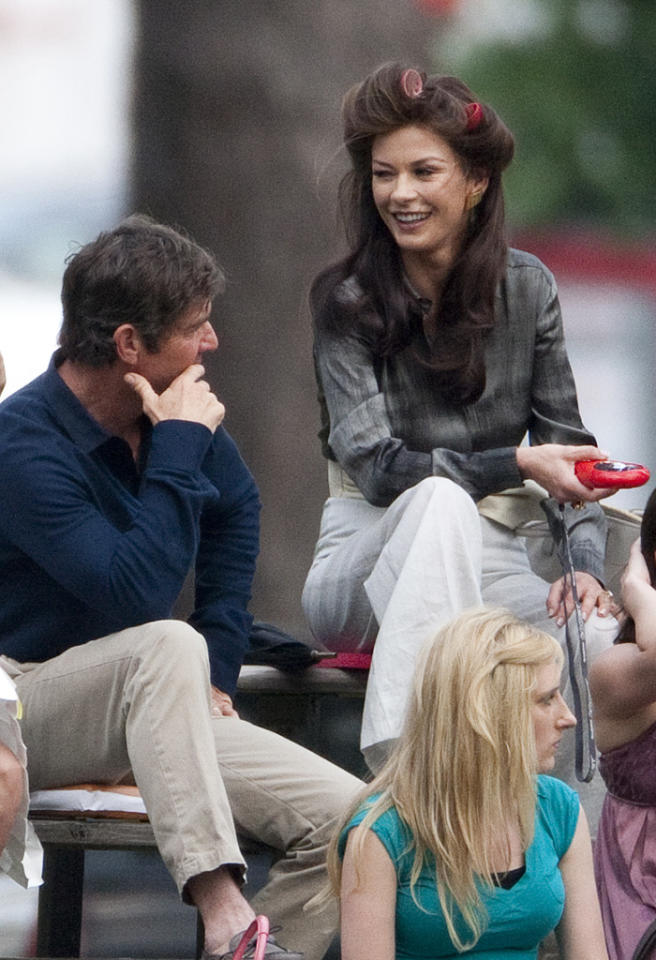 Catherine Zeta-Jones looks great on set as she jokes with Dennis Quaid and Uma Thurman in Louisiana. The actress wore her hair in curlers before scenes began on set of her latest movie 'Playing The Field', starring Gerard Butler, Uma Thurman, Dennis Quaid and Jessica Biel. The happy trio joked around on the bleachers in between takes. Pictured: Catherine Zeta-Jones, Uma Thurman and Dennis Quaid  Ref: SPL269872  200411  Picture by: Butters / Deano / Splash News   Splash News and Pictures Los Angeles:310-821-2666 New York:212-619-2666 London:870-934-2666 photodesk@splashnews.com