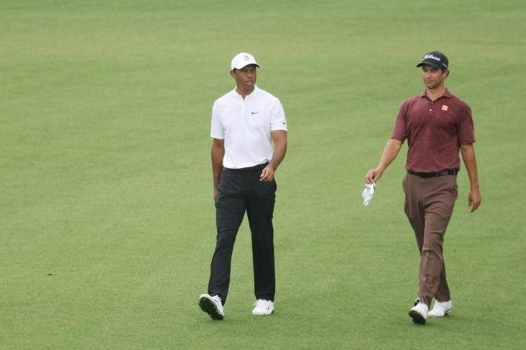 Defending champion Tiger Woods, left, walks with Australia's Adam Scott during a Wednesday practice round on the eve of the start of the 84th Masters