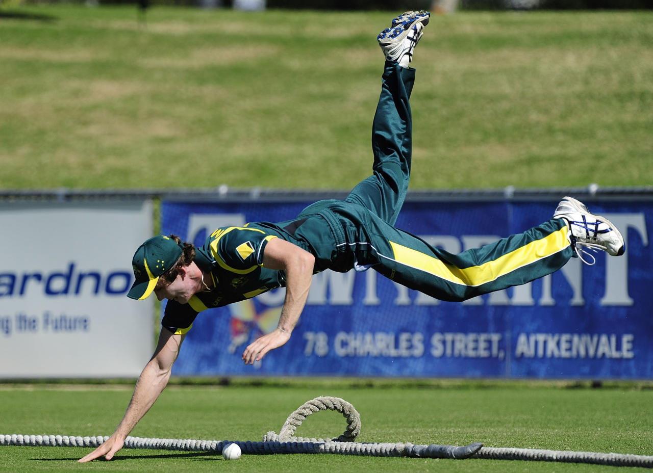 TOWNSVILLE, AUSTRALIA - APRIL 07:  Joshua McClelland of Australia attempts to save a boundary during the match between Australia and India on day two of the U19 International Quad Series at Tony Ireland Stadium on April 7, 2012 in Townsville, Australia.  (Photo by Ian Hitchcock/Getty Images)