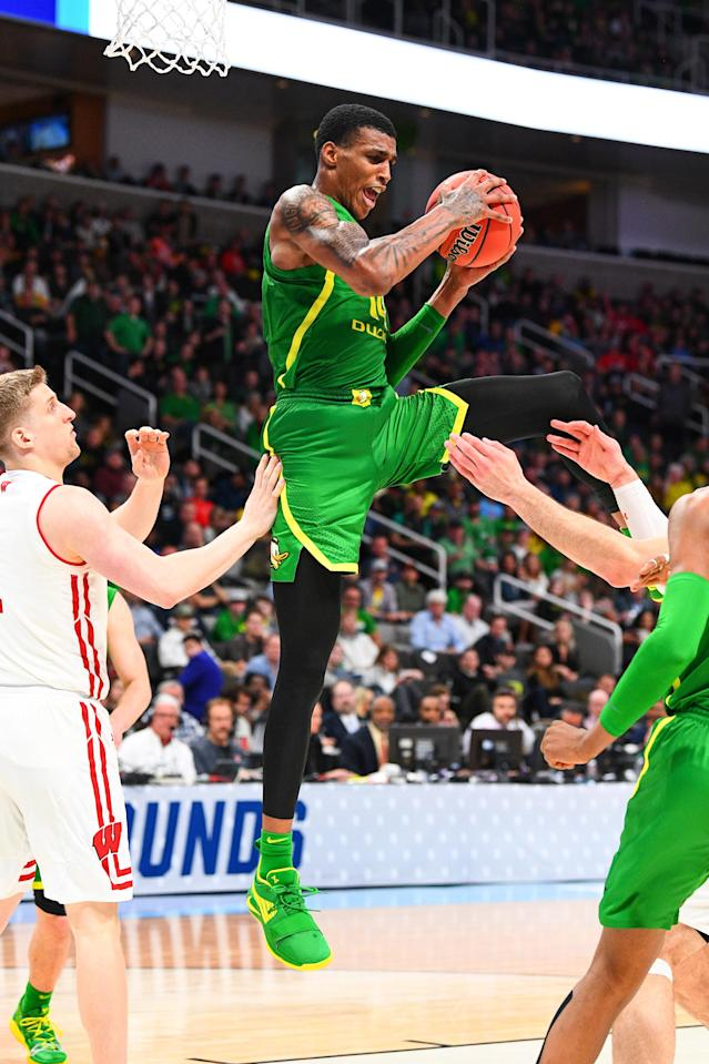 <p>Oregon forward Kenny Wooten (14) grabs a rebound in traffic during the game between the Wisconsin Badgers and the Oregon Ducks in their NCAA Division I Men's Basketball Championship first round game on March 22, 2019, at SAP Center at San Jose in San Jose, CA. </p>