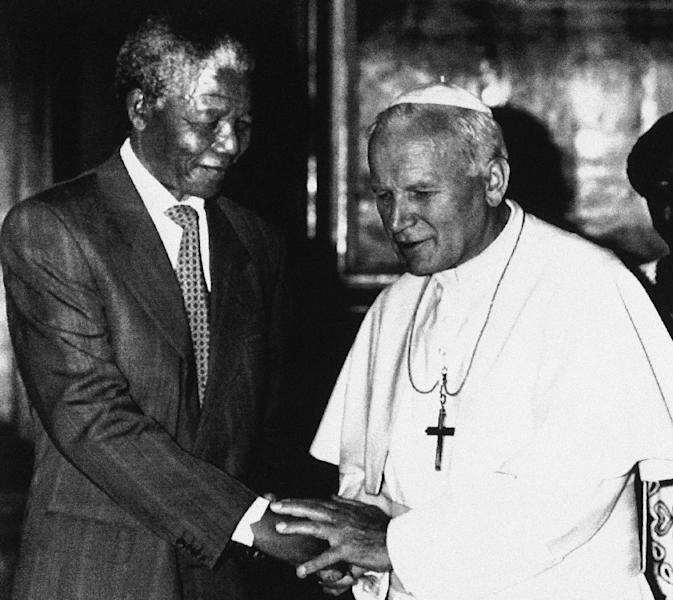 FILE - In this June 15, 1990 file photo, Pope John Paul II, right, shakes hands with Nelson Mandela, deputy leader of African National Congress, during a private audience at the Vatican. South Africa's president Jacob Zuma says, Thursday, Dec. 5, 2013, that Mandela has died. He was 95. (AP Photo/Claudio Luffoli, File)