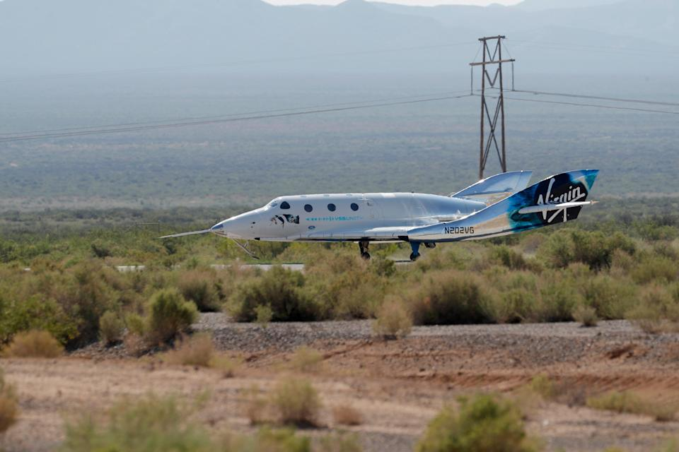 The Virgin Galactic rocket plane, with founder Sir Richard Branson and other crew members on board, lands back in Spaceport America, New Mexico (AP)