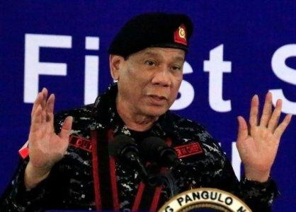 FILE PHOTO - Philippine President Rodrigo Duterte, wearing a military uniform, gestures as he delivers a speech during the 67th founding anniversary of the First Scout Ranger regiment in San Miguel town, Bulacan province, north of Manila, Philippines November 24, 2017. REUTERS/Romeo Ranoco