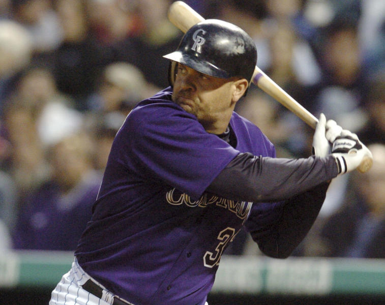 FILE - In this Wednesday, June 30, 2004 file photo, Colorado Rockies' Larry Walker gets ready to swing at a pitch from Milwaukee Brewers' Ben Sheets in the fourth inning of a baseball game in Denver. Derek Jeter came within one vote of being a unanimous pick for the Hall of Fame while Larry Walker also earned baseball's highest honor on Tuesday, Jan. 21, 2020 (AP Photo/David Zalubowski, File)