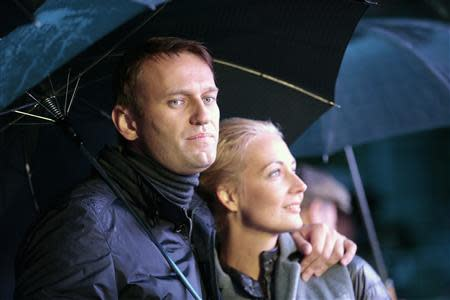 Mayoral candidate and opposition leader Alexei Navalny and his wife Yulia look on during a support rally in central Moscow September 6, 2013. REUTERS/Tatyana Makeyeva