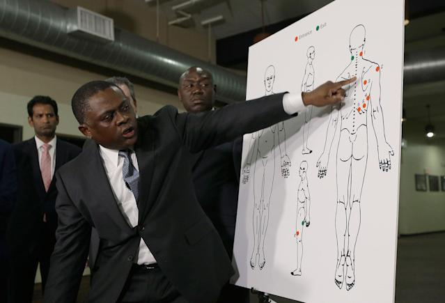 <p>Pathologist Dr. Bennet Omalu points to details in a diagram showing the gunshot wounds he found on the body of Stephon Clark who was shot by Sacramento police, during a news conference Friday, March 30, 2018, in Sacramento, Calif. Omalu was hired by the attorneys of the Clark family to perform the independent autopsy. (Photo: Rich Pedroncelli/AP) </p>