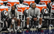 Houston Rockets guard James Harden, left, and forward P.J. Tucker watch from the bench during the second half of the team's NBA basketball game against the Denver Nuggets on Monday, Dec. 28, 2020, in Denver. The Nuggets won 124-111. (AP Photo/David Zalubowski)