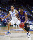 Abilene Christian's Jaylen Franklin (0) drives to the basket Kentucky's Jemarl Baker Jr. (13) during the first half of a first-round game in the NCAA mens college basketball tournament in Jacksonville, Fla. Thursday, March 21, 2019. (AP Photo/Stephen B. Morton)