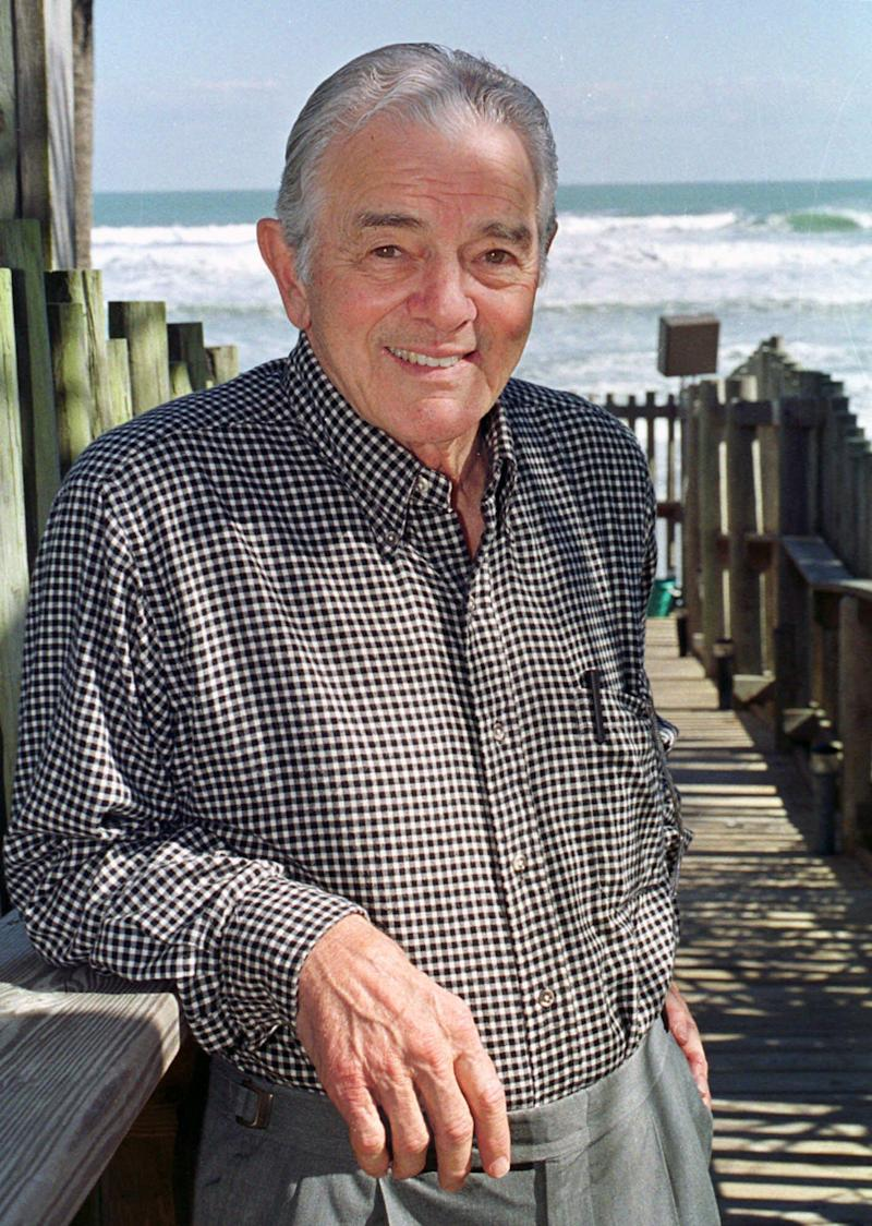 FILE - In this Dec.1999 file photo, Al Neuharth, founder of USA Today, poses at his home in Cocoa Beach, Fla. USA Today founder Al Neuharth has died in Cocoa Beach, Fla. He was 89. The news was announced Friday, April 19, 2013 by USA Today and by the Newseum, which he also founded. (AP Photo/Peter Cosgrove, File)
