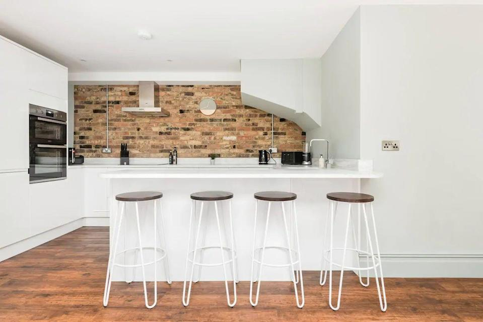 """<p>With greys, wood and marble throughout, this stylish house makes for a comfy and stylish place to rest your head after days out in the city. The Airbnb in Brighton's Kemptown is close to the pier and great for family or friends (providing Covid-19 laws permit), providing a trendy space for dining and socialising together.</p><p><strong>Sleeps: </strong>Six</p><p><strong>Price per night:</strong> £189.00</p><p><strong>Why we like it: </strong>Behind the minimalist grey facade, the house is warm and homely</p><p><a class=""""link rapid-noclick-resp"""" href=""""https://airbnb.pvxt.net/rnnm9Q"""" rel=""""nofollow noopener"""" target=""""_blank"""" data-ylk=""""slk:SEE INSIDE"""">SEE INSIDE</a></p>"""