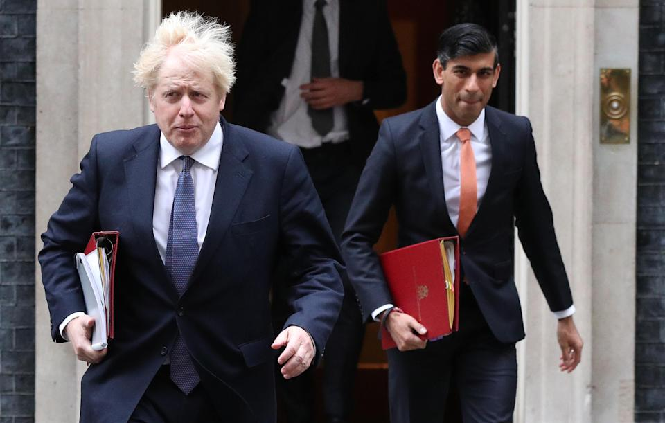 Prime Minister Boris Johnson (left) and Chancellor of the Exchequer Rishi Sunak leave 10 Downing Street London, ahead of a Cabinet meeting at the Foreign and Commonwealth Office.