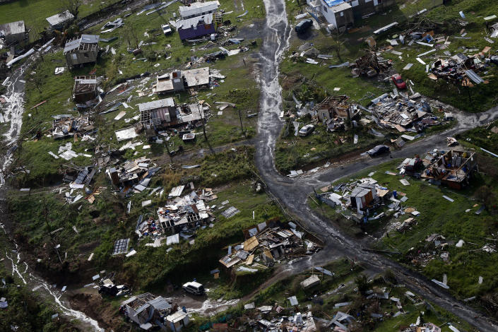 FILE - In this Sept. 28, 2017 file photo, destroyed communities are seen in the aftermath of Hurricane Maria in Toa Alta, Puerto Rico. Researchers said on April 22, 2021, they are launching a survey of the causes of deaths following the Category 4 storm to clear up questions about a death toll that analysts so far have attributed to factors such as power outages, building failures, and damaged roads. (AP Photo/Gerald Herbert, File)