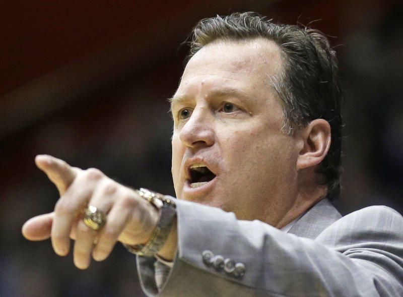 North Carolina State coach Mark Gottfried talks to his players during the second half against Xavier in a first-round game of the NCAA college basketball tournament, Tuesday, March 18, 2014, in Dayton, Ohio. (AP Photo/Al Behrman)