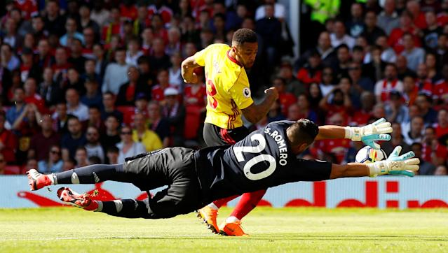 "Soccer Football - Premier League - Manchester United vs Watford - Old Trafford, Manchester, Britain - May 13, 2018 Watford's Andre Gray in action with Manchester United's Sergio Romero Action Images via Reuters/Jason Cairnduff EDITORIAL USE ONLY. No use with unauthorized audio, video, data, fixture lists, club/league logos or ""live"" services. Online in-match use limited to 75 images, no video emulation. No use in betting, games or single club/league/player publications. Please contact your account representative for further details."
