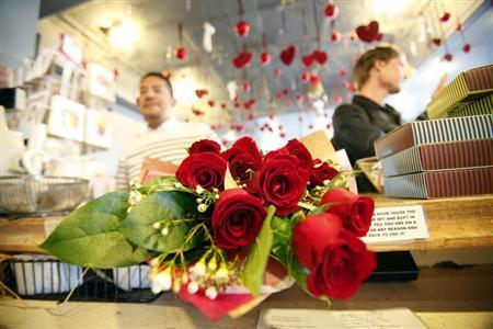 A person purchases roses at florist on Valentine's Day in Los Angeles