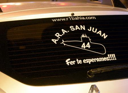 "A sticker in commemoration of the 44 crew members of the missing at sea ARA San Juan submarine is seen on the windshield of a car of a victim's relative outside a hotel where relatives are staying in Mar del Plata, Argentina November 17, 2018. Words below read ""Fer, We are waiting for you""  REUTERS/Marina Devo"