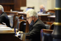 State Sen. Larry Grooms, R-Bonneau, sits at his desk during debate over a bill that would ban almost all abortions in the state on Thursday, Jan. 28, 2021 in Columbia, S.C. Grooms voted for the bill on an initial vote. (AP Photo/Jeffrey Collins)