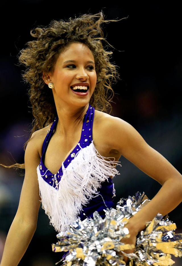 KANSAS CITY, MO - MARCH 13: TCU Horned Frogs cheerleaders perform during the first round of the 2013 Big 12 Men's Basketball Championship at Sprint Center on March 13, 2013 in Kansas City, Missouri. (Photo by Jamie Squire/Getty Images)