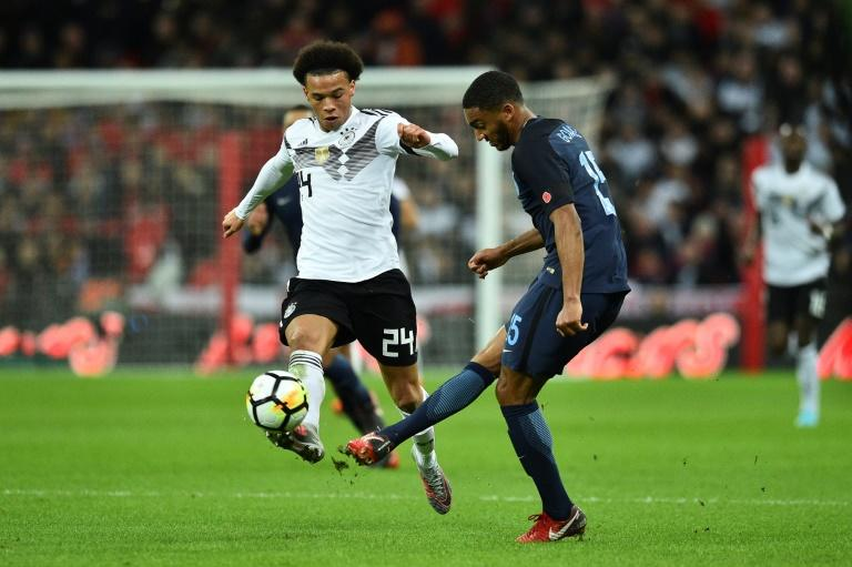 England's Joseph Gomez (R) vies with Germany's Leroy Sane (L) during their match at Wembley Stadium in London on November 10, 2017