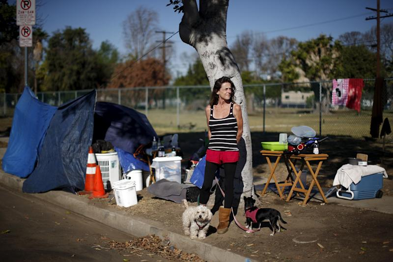 Stacie McDonough, 51, is an army veteran with a college degree who was made made homeless. In this Oct. 2015 picture, she's seen posing by her tent near LAX airport in Los Angeles, California.