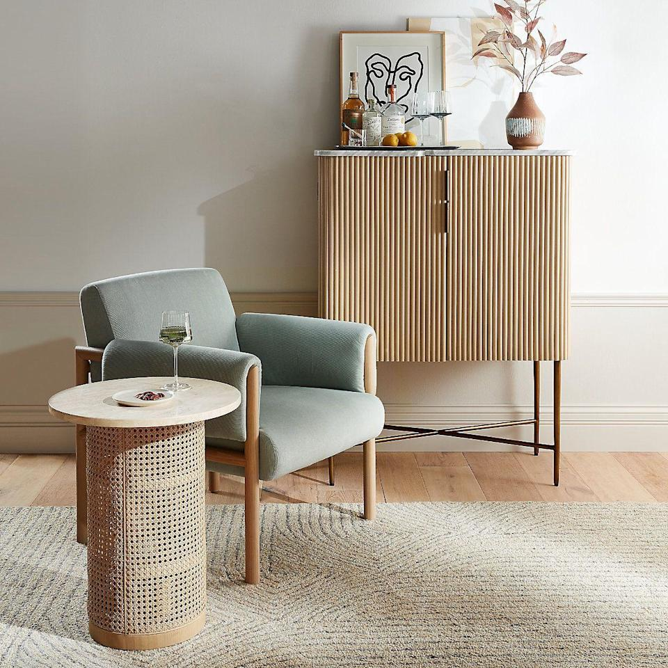 "<p><strong>crate and barrel</strong></p><p>crateandbarrel.com</p><p><strong>$1299.00</strong></p><p><a href=""https://go.redirectingat.com?id=74968X1596630&url=https%3A%2F%2Fwww.crateandbarrel.com%2Ffayette-bar-cabinet%2Fs561862&sref=https%3A%2F%2Fwww.housebeautiful.com%2Fshopping%2Ffurniture%2Fg33525951%2Fbar-cabinets%2F"" rel=""nofollow noopener"" target=""_blank"" data-ylk=""slk:BUY NOW"" class=""link rapid-noclick-resp"">BUY NOW</a></p><p>This curved cabinet combines mango and oak veneer with a marble top for sleek style. Open it up, and you'll find a stemware rack and three adjustable shelves with notches to keep your bottles in place. </p>"