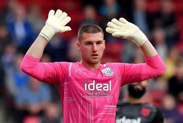 West Bromwich Albion goalkeeper Sam Johnstone gestures with both hands out to the side and above his head