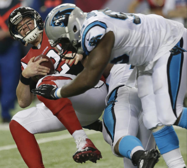 Atlanta Falcons quarterback Matt Ryan (2) is sacked by Carolina Panthers defensive end Greg Hardy (76) and Carolina Panthers defensive end Charles Johnson (95) during the second half of an NFL football game, Sunday, Dec. 29, 2013, in Atlanta. (AP Photo/Dave Martin)
