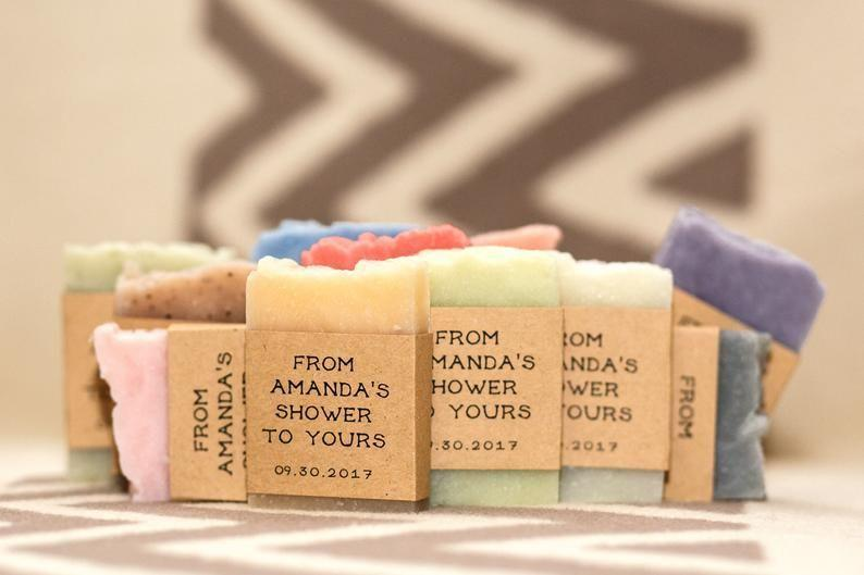 """<p><strong>RusticJoySoap</strong></p><p>etsy.com</p><p><strong>$41.20</strong></p><p><a href=""""https://go.redirectingat.com?id=74968X1596630&url=https%3A%2F%2Fwww.etsy.com%2Flisting%2F263785472%2Fwedding-soap-favors-mini-soap-bridal&sref=https%3A%2F%2Fwww.countryliving.com%2Fentertaining%2Fg27396315%2Fbridal-shower-favor-ideas%2F"""" rel=""""nofollow noopener"""" target=""""_blank"""" data-ylk=""""slk:Shop Now"""" class=""""link rapid-noclick-resp"""">Shop Now</a></p><p>Give your guests something from you shower for their shower with these miniature soap bars. They come complete with custom labels. </p>"""