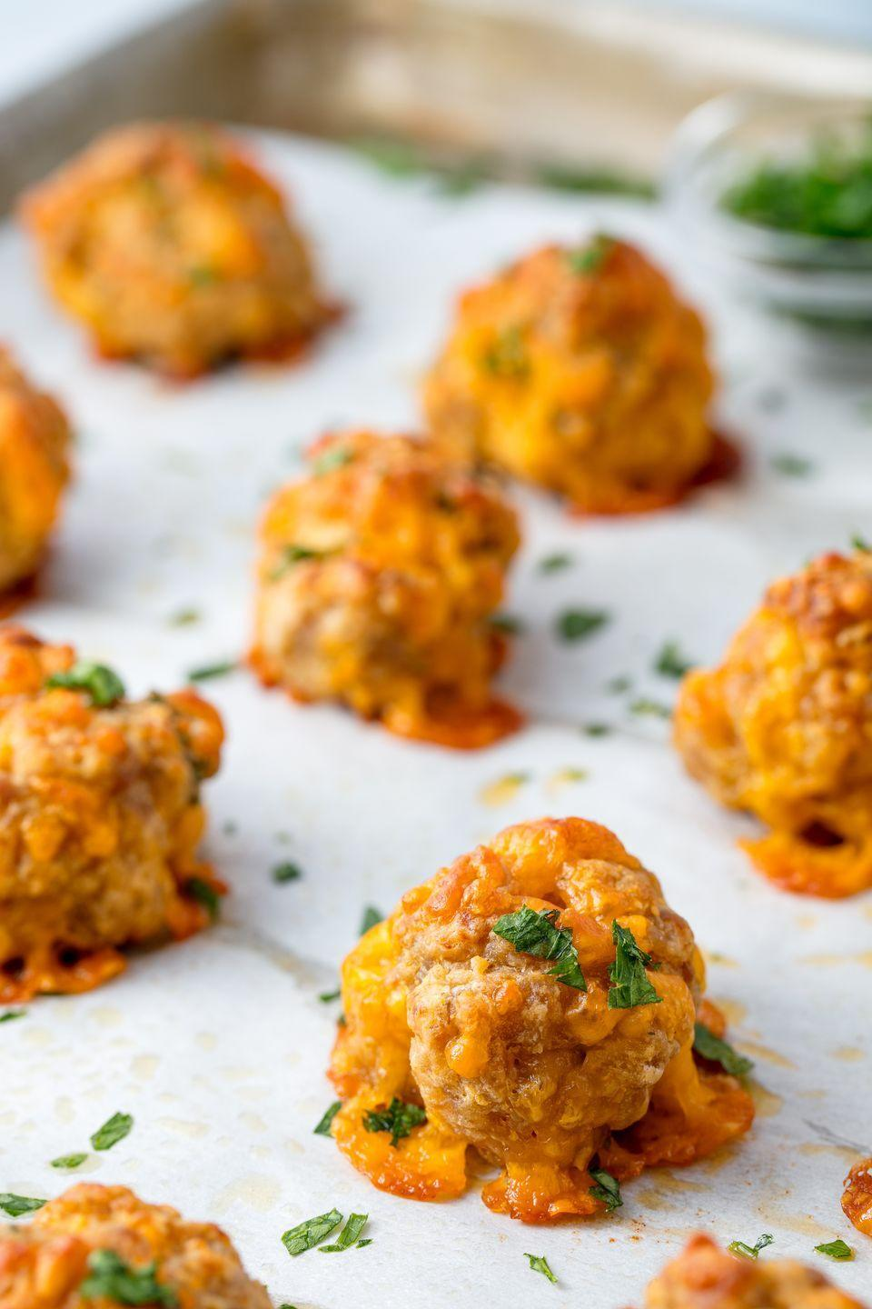 "<p>Addictive bites of cooked pork sausage, cheddar, and Bisquick. </p><p>Get the recipe from <a href=""https://www.delish.com/cooking/recipe-ideas/recipes/a54969/sausage-balls-recipe/"" rel=""nofollow noopener"" target=""_blank"" data-ylk=""slk:Delish"" class=""link rapid-noclick-resp"">Delish</a>. </p>"