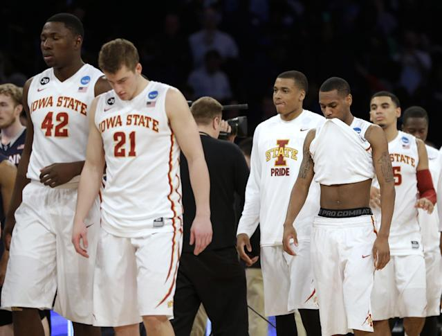 Iowa State players leave the court after losing to Connecticut 81-76 in a regional semifinal at the NCAA men's college basketball tournament Friday, March 28, 2014, in New York. (AP Photo/Seth Wenig)