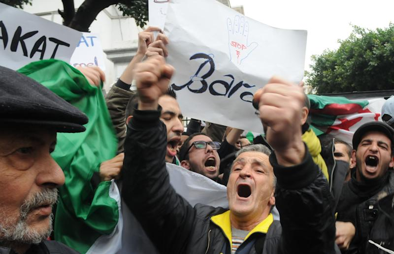 """Demonstrators from the """"Barakat!"""" (""""Enough"""") group, protest during a rally against Algerian President Abdelaziz Bouteflika, Saturday, March 15, 2014 in Algiers. About 100 Algerian activists from a new anti-government movement staged a rare protest Saturday against the ailing president and his decision to run for a fourth term. Elections will take place on April 17, 2014. ( AP Photo/Ouahab Hebbat)"""