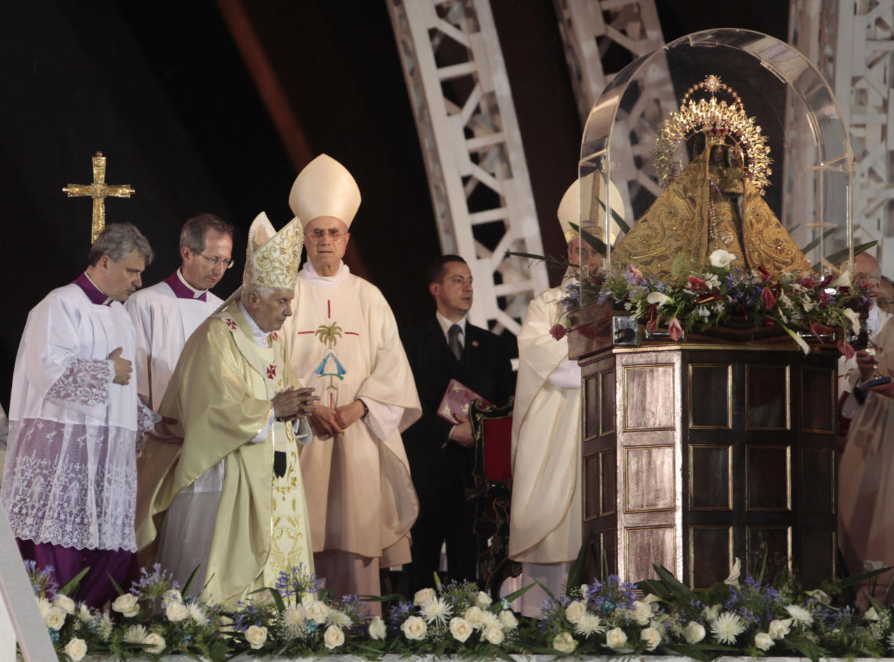 Pope Benedict XVI walks by the Virgen of the Chariry of Cobre as he arrives to celebrate a Mass at Revolution Square where giving a mass in Santiago de Cuba, Cuba, Monday, March 26, 2012. (AP Photo/Esteban Felix)