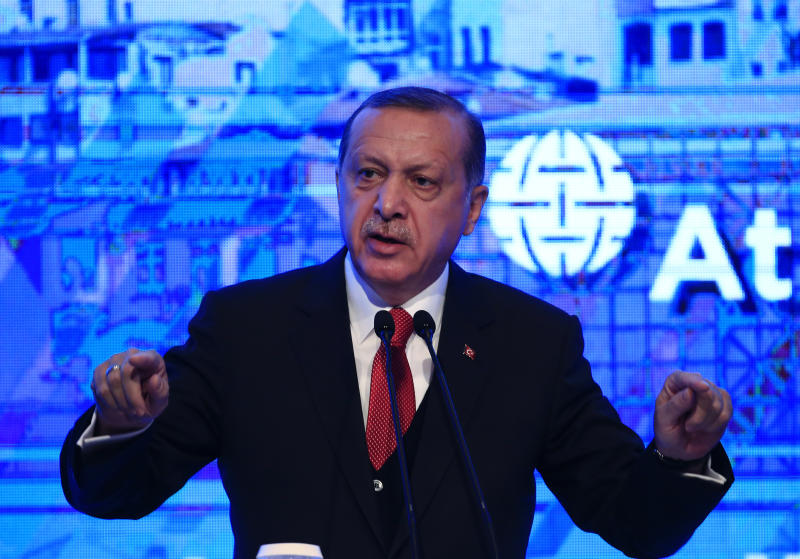 """Turkey's President Recep Tayyip Erdogan, applauds the organisers after delivering a speech at an Atlantic Council event in Istanbul, Friday, April 28, 2017.  Erdogan repeated his criticism of the U.S. alliance with Syrian Kurdish militias that Turkey deems """"terrorists."""" Erdogan and US President Donald Trump are scheduled to meet on May 16 in Washington. (AP Photo/Lefteris Pitarakis)"""