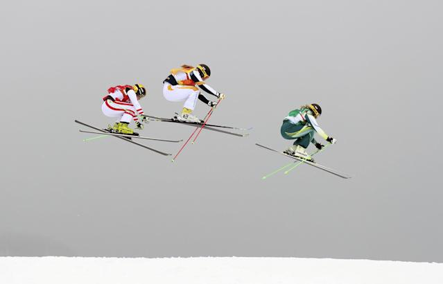 """Freestyle Skiing - Pyeongchang 2018 Winter Olympics - Women's Ski Cross Finals - Phoenix Snow Park - Pyeongchang, South Korea - February 23, 2018 - Lisa Andersson of Sweden, Andrea Limbacher of Austria and Sami Kennedy-Sim of Australia compete. REUTERS/Mike Blake SEARCH """"OLYMPICS BEST"""" FOR ALL PICTURES. TPX IMAGES OF THE DAY."""