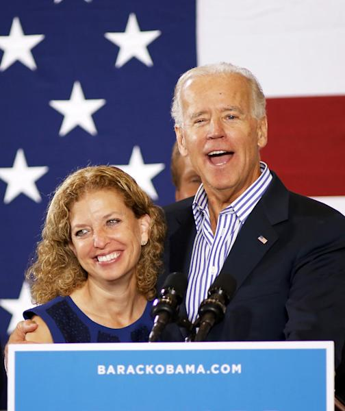 Vice President Joe Biden hugs Democratic National Committee Chair, Rep Debbie Wasserman Schultz, D-Fla., during a campaign event at the Century Village Clubhouse in Boca Raton, Fla., Friday, Sept. 28, 2012. (AP Photo/Terry Renna)