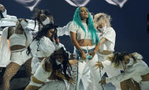 Karol G performs with backup dancers at the Billboard Music Awards, Friday, May 21, 2021, at the Microsoft Theater in Los Angeles. The awards show airs on May 23 with both live and prerecorded segments. (AP Photo/Chris Pizzello)