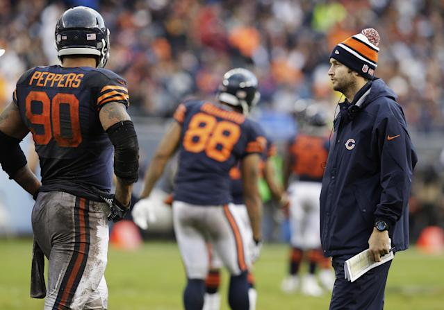 Injured Chicago Bears quarterback Jay Cutler, right, talks with defensive end Julius Peppers (90) during the first half of an NFL football game against the Baltimore Ravens, Sunday, Nov. 17, 2013, in Chicago. (AP Photo/Nam Y. Huh)