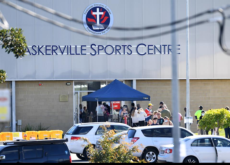 People line up to get COVID-19 tested at the Parklands Christian College in Logan, south of Brisbane on Wednesday,  after an employee tested positive.  Source: AAP